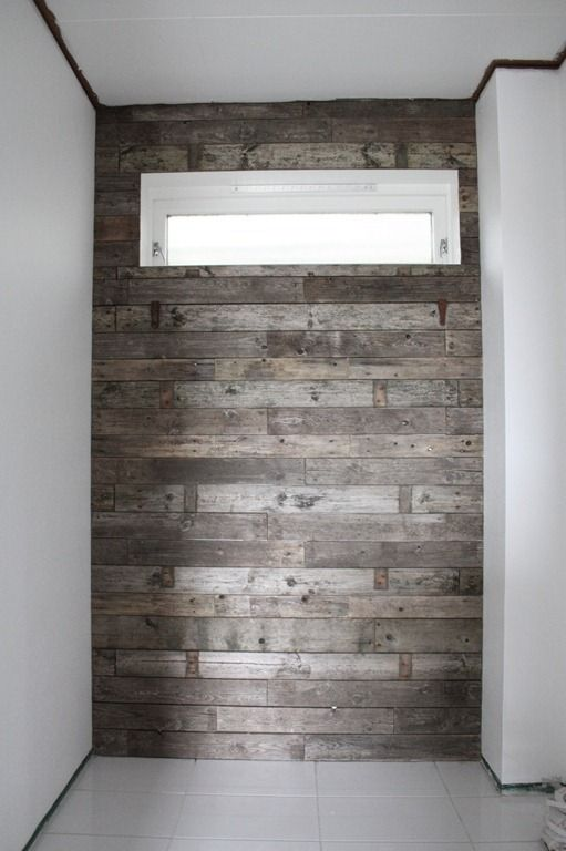 Wall out of old planks.  Could be nice in a bathroom with plank sink.