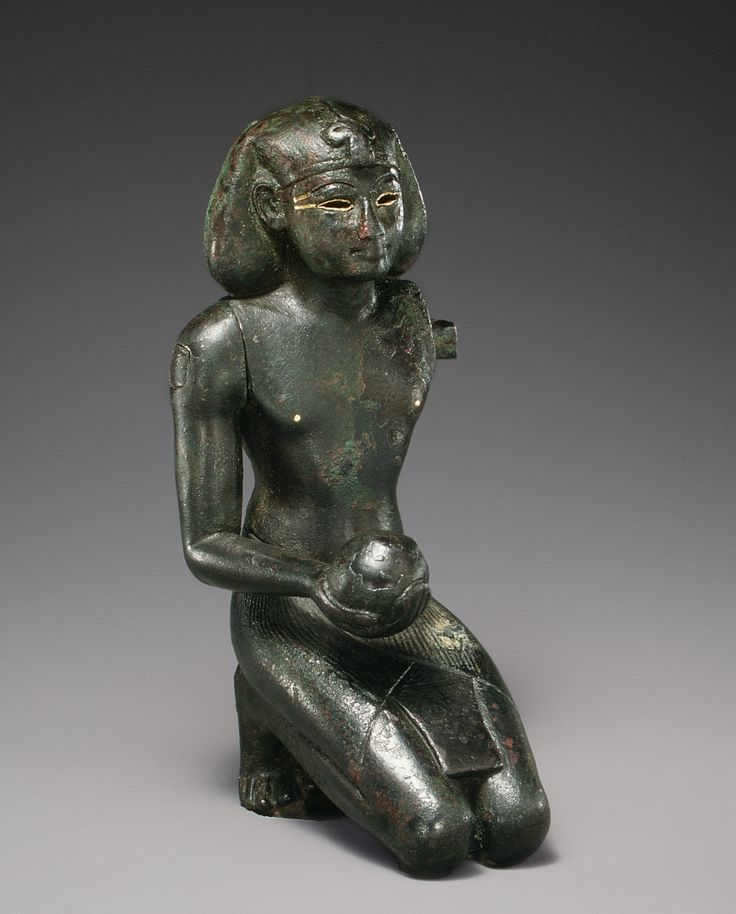 Ritual Statuette of Thutmose III  Period: New Kingdom Dynasty: Dynasty 18 Reign: reign of Thutmose III Date: ca. 1479–1425 B.C. Geography: From Egypt Medium: Black bronze, gold inlay Dimensions: h. 13.1 cm (5 1/8 in) [16.2 cm (6 3/8 in) with tang]; w. 6.0 cm (2 3/8 in); d. 7.6 cm (3 in)