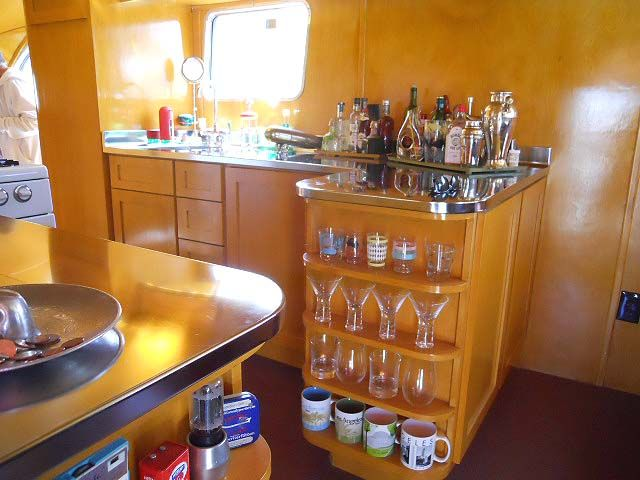 warm and glowing interior birch cabinets in 1948 spartan manor trailer cottage on wheels. Black Bedroom Furniture Sets. Home Design Ideas