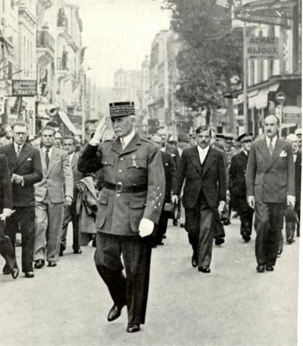Marshal Philippe Pétain, Head of State of the Etat Francaise, with, to his left and behind, his Prime Minister Piérre Laval, process to a chruch service at Vichy.
