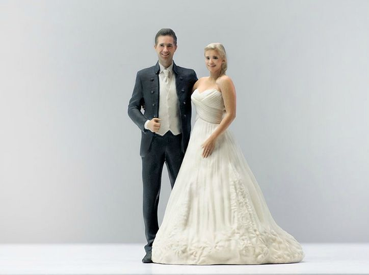 Yup- that's a 3-d printed figurine that looks exactly like you #weddingcaketopper