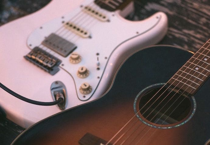 Electric Vs Acoustic Guitar Whats The Difference In 2020 Best Acoustic Guitar Guitar Acoustic