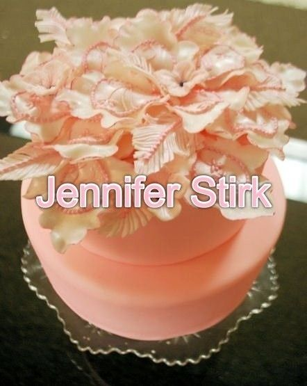 Pink feather pearl.  gumpaste and fondant details