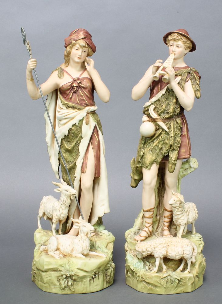 "Lot 30, A pair of Royal Dux figures of a shepherd and shepherdess 15"" est £50-100"