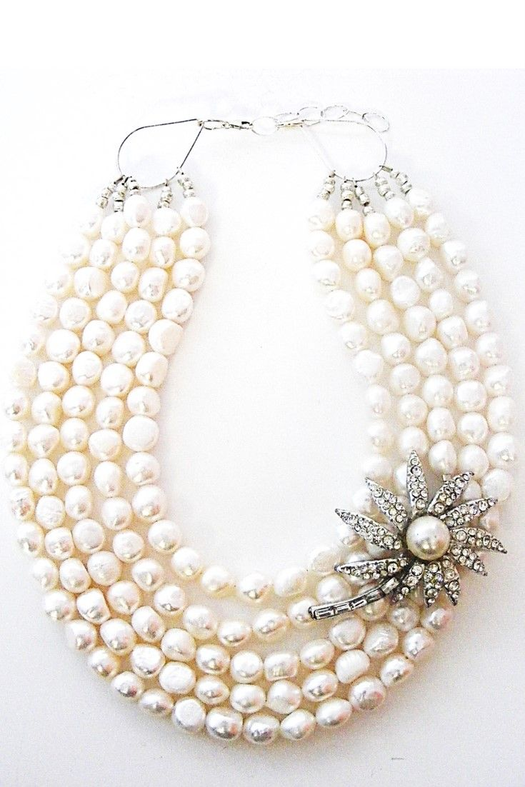 White freshwater pearl & Vintage Pearl flower brooch necklace.  One-of-a-kind statement necklace handmade with white freshwater pearls paired with vintage brooch $345,00. #statementnecklaces#necklaces#freshwaterpearl#handmadenecklace