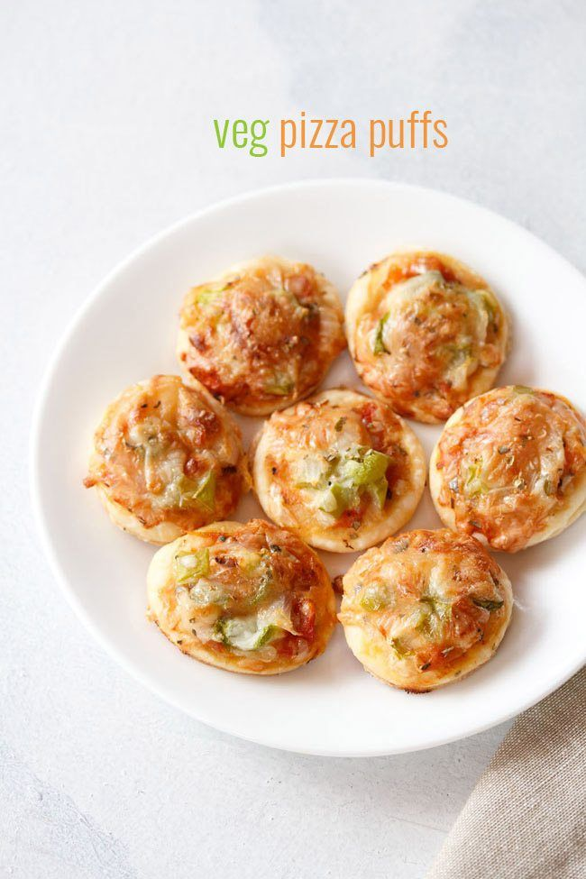 veg pizza puffs recipe with step by step photos - easy method of preparing bite sized puffs made with pizza toppings.    sharing a very simple yettasty recipe of veg pizza puffs. this recipe of veg pizza