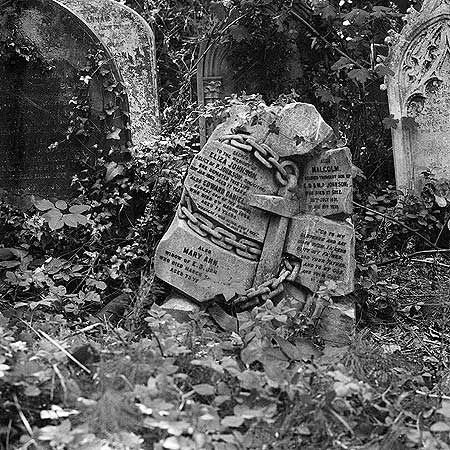 sunken ship victims gravestone wrapped in an anchor. highgate cemetery