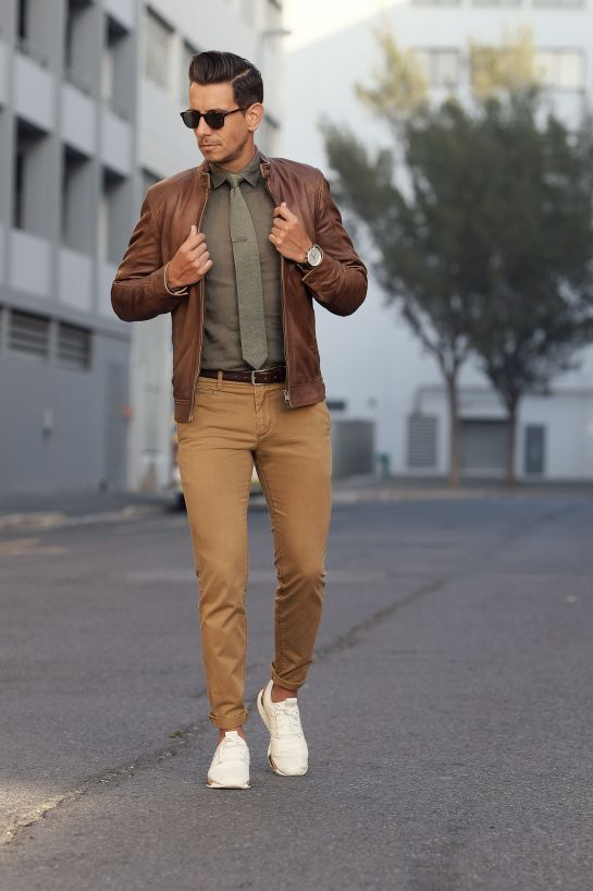 Brown leather jacket + olive green button up and tie + khakis + white sneakers