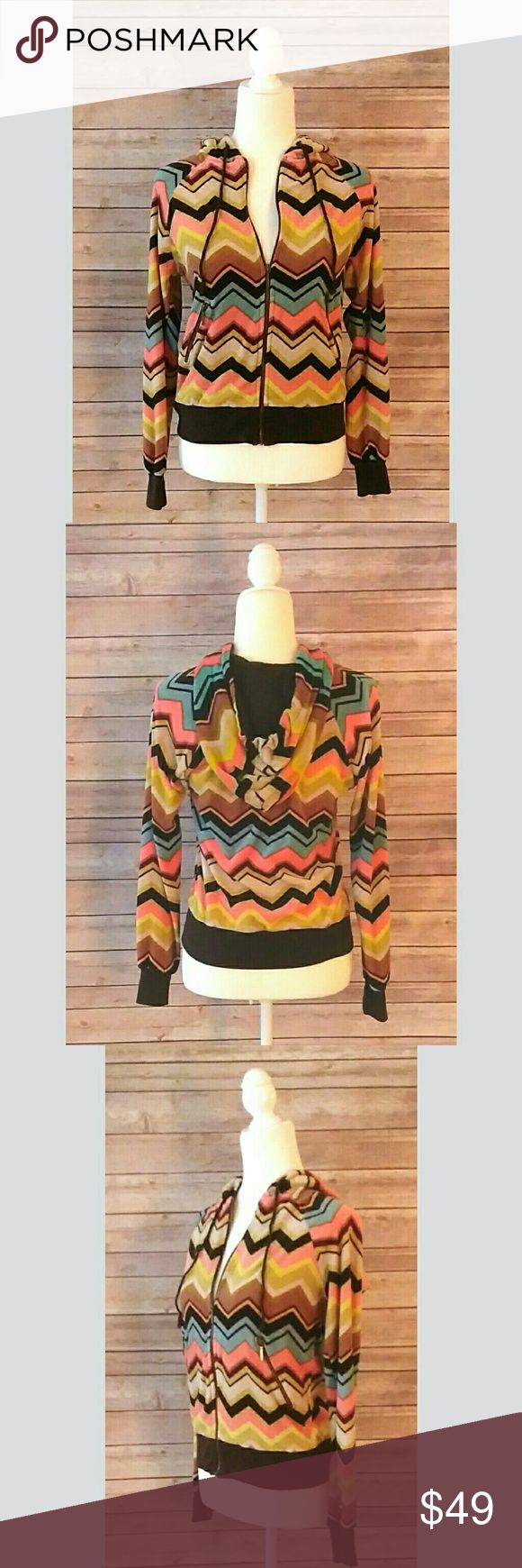 Missoni for Target multicolor velour zip up hoodie Missoni for Target hoodie in a multicolor print.  It has the iconic chevron pattern in brown, tan, yellow, turquoise, pink and burgundy.  It has zippered side pockets.  The hood has a solid brown lining and a brown cord.  Waist and cuffs have a brown trim.  Excellent condition.   Pet free smoke free home. Bin1812 Missoni Tops Sweatshirts & Hoodies