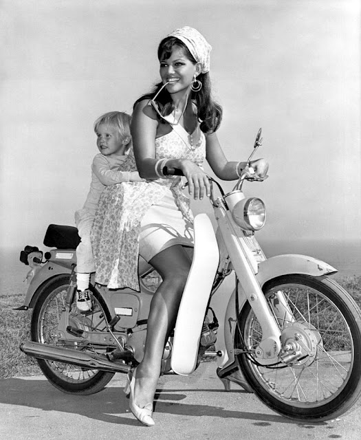 Claudia Cardinale and her son on a Honda, c.1957