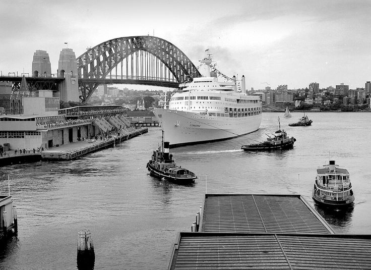 Departure of the Liner (ship) Canberra from International Terminal, Circular Quay, Sydney Harbour with tugs. Max Dupain photo, 1967.