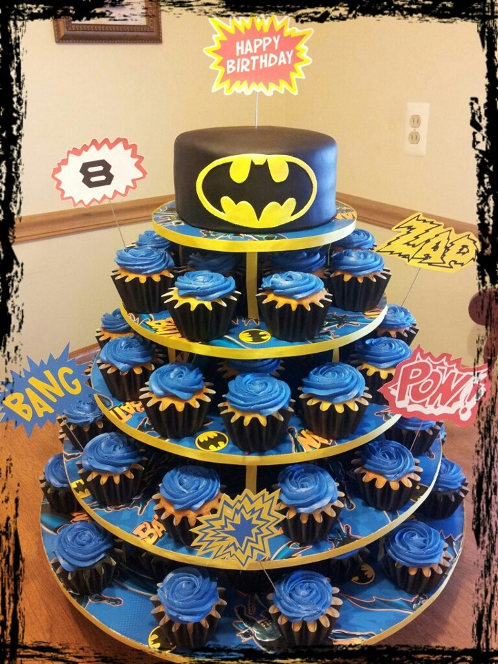 Children's Birthday Cakes - Batman cake / cupcake tree.  How:  cupcaketree.com original mini round tree, batman gift wrap, yellow ribbon, small glue dots (for attaching ribbon), wilton black cupcake liners (filled just less than 1/4 cup of batter for each cupcake), super white frosting colored with wilton royal blue food coloring plus powdered food coloring in royal blue, fondarific black fondant, yellow gumpaste / fondant mixture, printouts on cardstock taped to wires.  My son loved it!