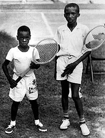 In 1954: Arthur Ashe, age 10, with Biff Henderson (left), at a segregated tournament in Durham, N.C.