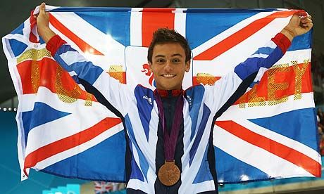 Tom Daley of Team GB with his Olympic bronze medal after the men's 10m platform diving.
