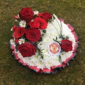 Manchester United Red and White Massed Posy Pad (Size 30cm )  hand delivered in Manchester , Salford , eccles , Winton , Peel Green , Irlam , Cadishead , Urmston , Flixton , Old Trafford