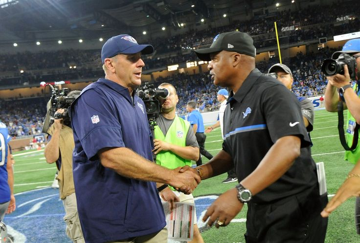 Tennessee Titans head coach Mike Mularkey, left, shakes hands with Detroit Lions head coach Jim Caldwell after their NFL football game, Sunday, Sept. 18, 2016, in Detroit. The Titans defeated the Lions 16-15.(AP Photo/Jose Juarez)