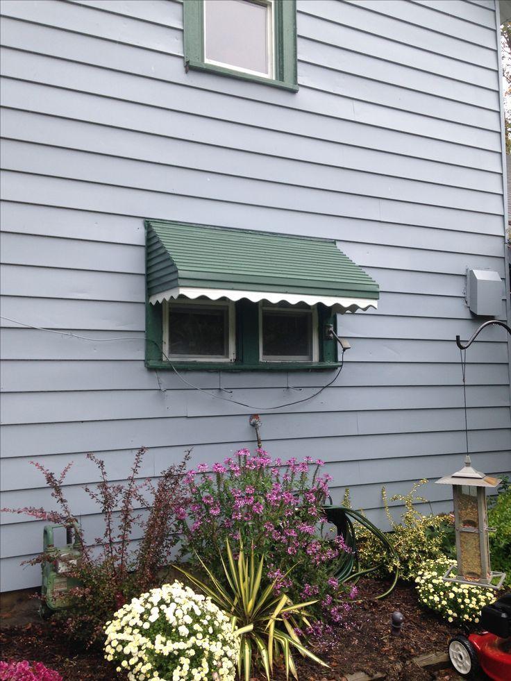 Small green aluminum door awning #aluminumawning #yearround www.jamestownawning.com