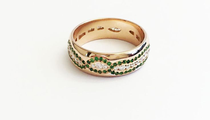 This is a wedding ring, inspired by the Northern Lights.