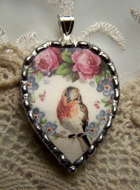 Broken china heart charm with a sweet little bird.