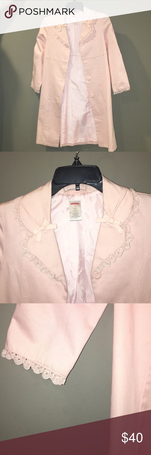 Gymboree Girls Pale Pink Trench Coat Gorgeous girls trench coat with beautiful lace detailing and bows as you may see in the images above. The inside is a comfortable satin material and there are buttons going down the coat. You may find on my closet listings a matching dress for this adorable coat! Gymboree Jackets & Coats
