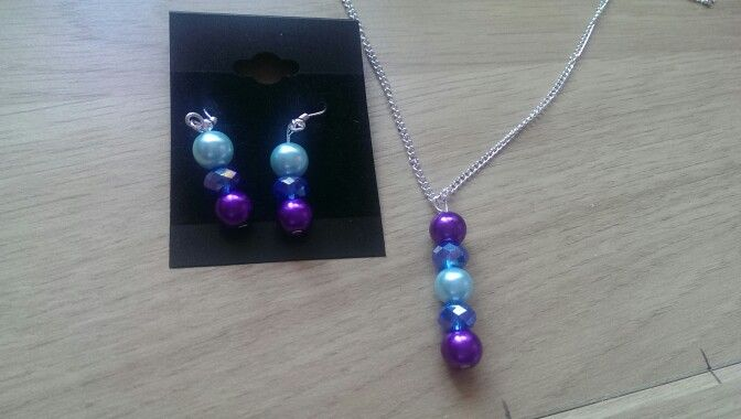 Baby blue & dark orchid pearls with sapphire crystal