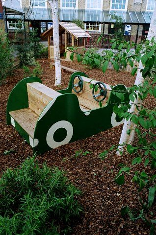 School play area with play car, western red cedar play house and balance beam with play bark surfacing
