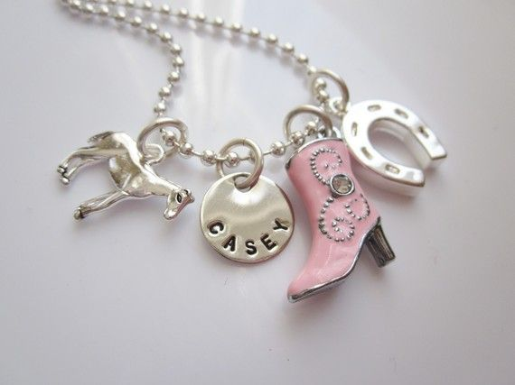 Personalized Horseback Riders Charm Necklace for Little Cowgirls from the Belle Bambine girl's Line. This silver sparkling charm necklace will make any little girl gallop!