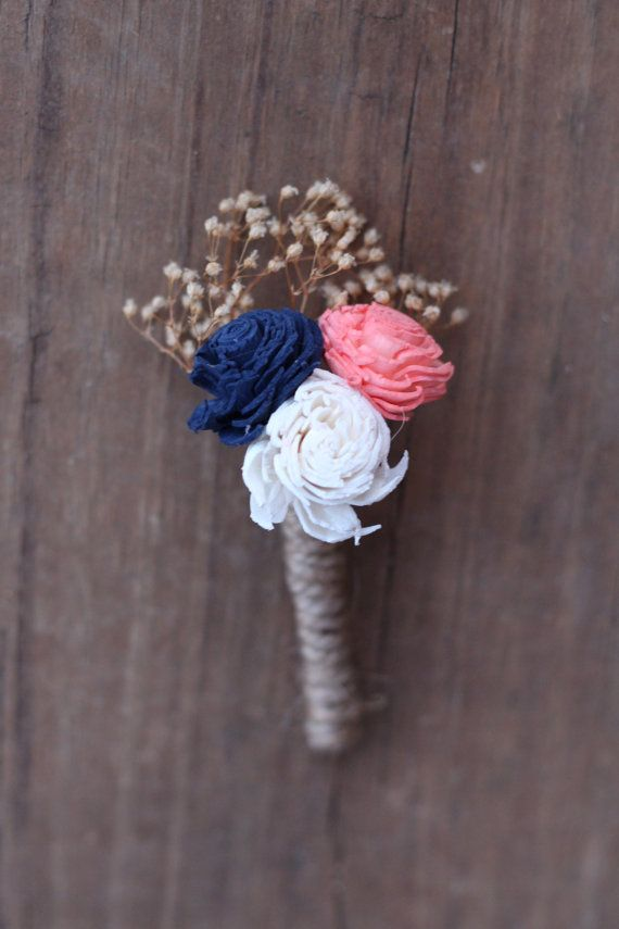This listing is a navy blue and coral boutonniere with tan babies breath wrapped in twine. The mini flowers measures between 1 and 1 3/4.