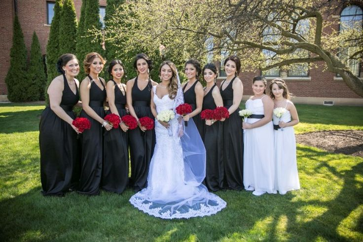 Upscale Plymouth Wedding at The Inn at St. John's, MI  Stunning black bridesmaid dresses with red rose bouquets!   Photographer: Green Holly Photography