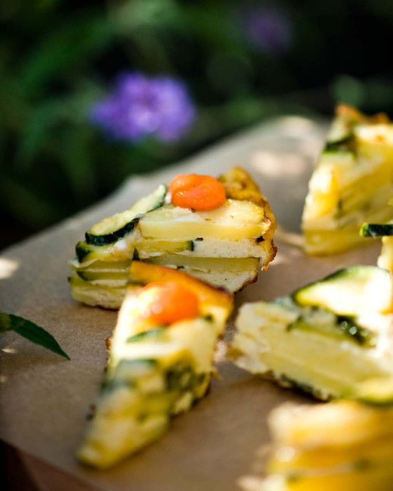 Layered with potato and zucchini and sliced in delicate triangles, this Spanish classic is fabulous finger food.