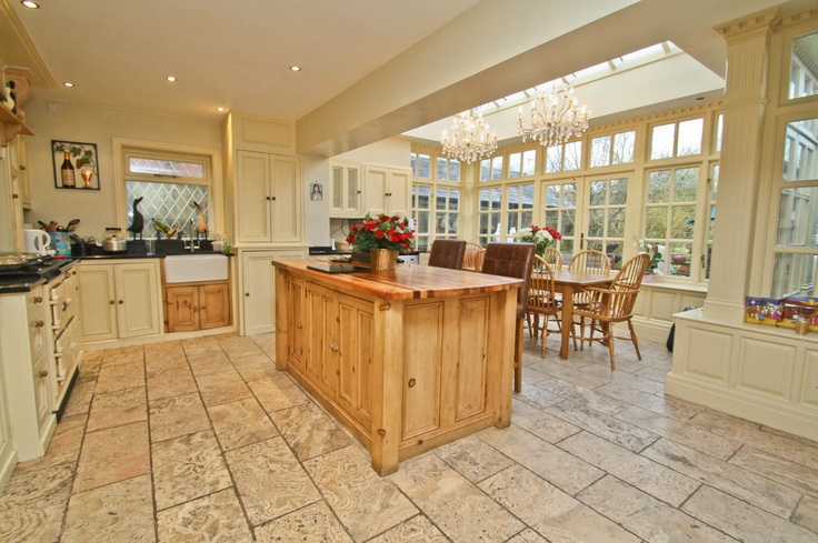 One of our favourite kitchens - oak units opening up into a double height orangery big enough for all the family