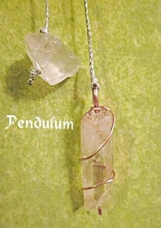 Pendulum with clear quartzes and copper wire.The main quartz has iron inside which gives it a beautiful red color.  Excellent for healing chakras and perfect for connecting you with Spirits!!