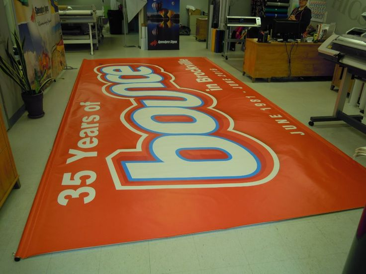 Speedpro Signs KIngston completed this full colour banner is 'BIG' … sized at 20 ft wide x 10 ft in height. It is being fastened to an existing wall by bars along the width of the banner by SHOWMEE. Awesome!