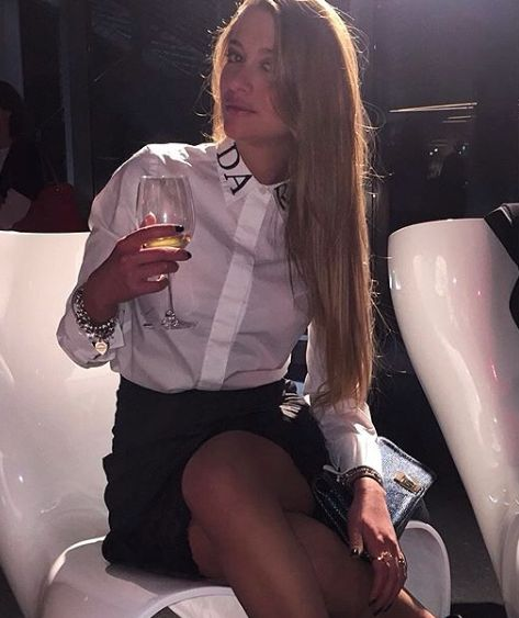 "Angelica Damore wearing loose-fit cotton blouse ""Eisen"" available on our shop online"