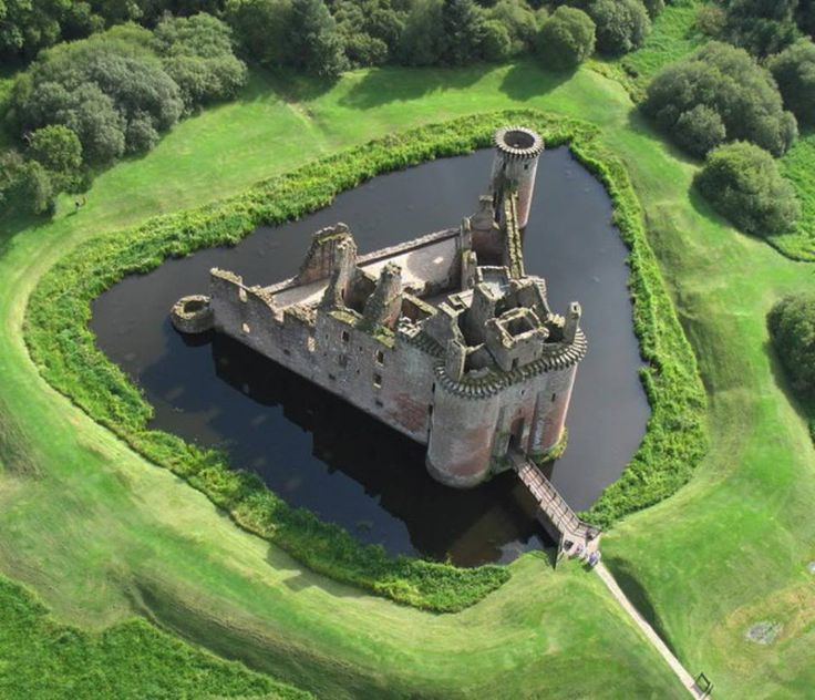 Caerlaverock Castle ruins near Dumfries, Scotland - Caerlaverock castle is a moated, triangular fortress, that is unique in Scotland. It was a frontline defense against the English, as it was constructed near the solway firth, which is the border between England and Scotland. Constructed in the 13th century, by the Maxwell family, it saw much action, and many sieges. After a siege in 1640, the castle was abandoned forever.