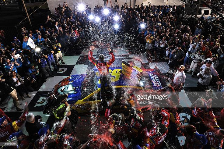 Carl Edwards, driver of the #99 Kellogg's / Cheez-It Ford, celebrates in Victory Lane after winning the NASCAR Sprint Cup Series 56th Annual Federated Auto Parts 400 at Richmond International Raceway on September 7, 2013 in Richmond, Virginia.