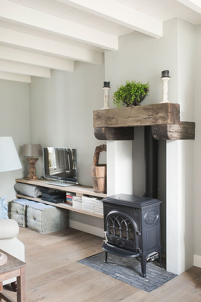 Love the natural wood mantel.