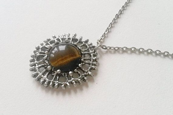 Tapani Vanhatalo (FI), vintage brutalist pewter pendant necklace with a tiger's eye cabochon, 1970s.  #finland | finlandjewelry.com