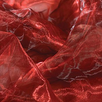 Choose Red Iridescent Chiffon to decorate prom walls or prom tables.  This shiney prom material is sheer and makes prom decorating easy.