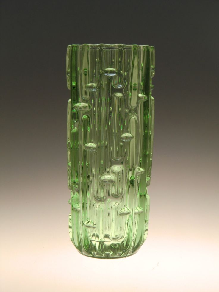 A personal favourite from my Etsy shop https://www.etsy.com/listing/482295677/czech-bohemian-art-glass-green-vase-by