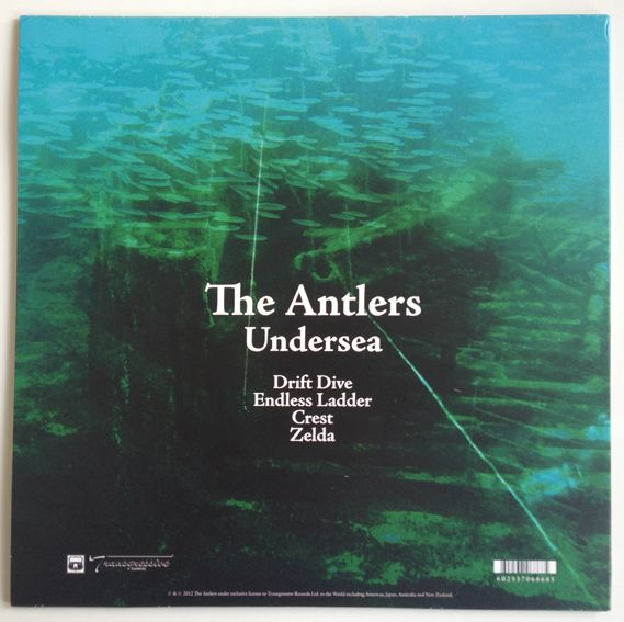 Also opting for a colourful, text free front cover is this four track release by The Antlers entitled Undersea. The vinyl is an appropriately slightly translucent bluey-green colour.