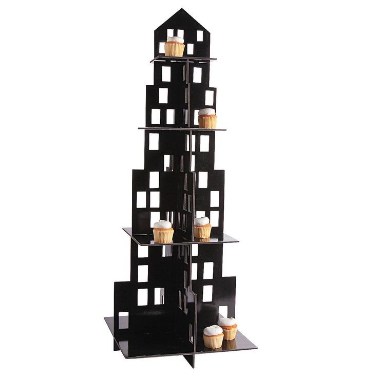"""Large City Cupcake Holder - OrientalTrading.com  IN-13604647 Complete your party's skyline with a treat or appetizer display that's sure to stand out. With 4 tiers, this Large City Cupcake Holder has plenty of space to feature plenty of food. This black foam building features cutout windows. Makes a must-have addition for specific city party themes! Foam. 16"""" x 42"""" Simple assembly required. © OTC"""