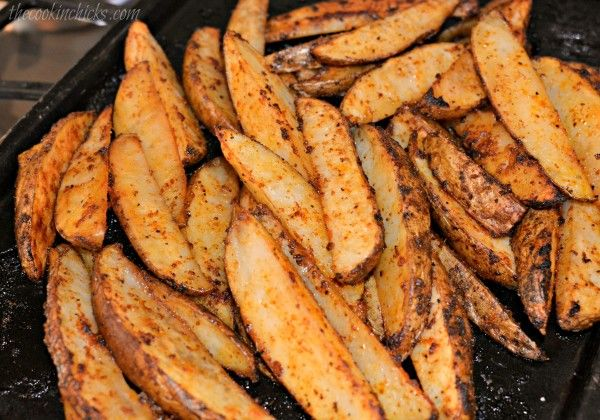 Ingredients       	8 Russet potatoes, scrubbed and cut into wedges   	1/4 cup olive oil   	1 tsp garlic powder   	1 tsp seasoned salt   	1/2 tsp ground black pepper   	1 tsp onion powder   	1/4 cup Parmesan cheese, grated          Instructions