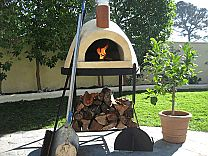 Primavera60 Pizza Oven – Forno Bravo | I'd like the terra cotta one for my own outdoor kitchen one day.  We'll have pizza night every night!