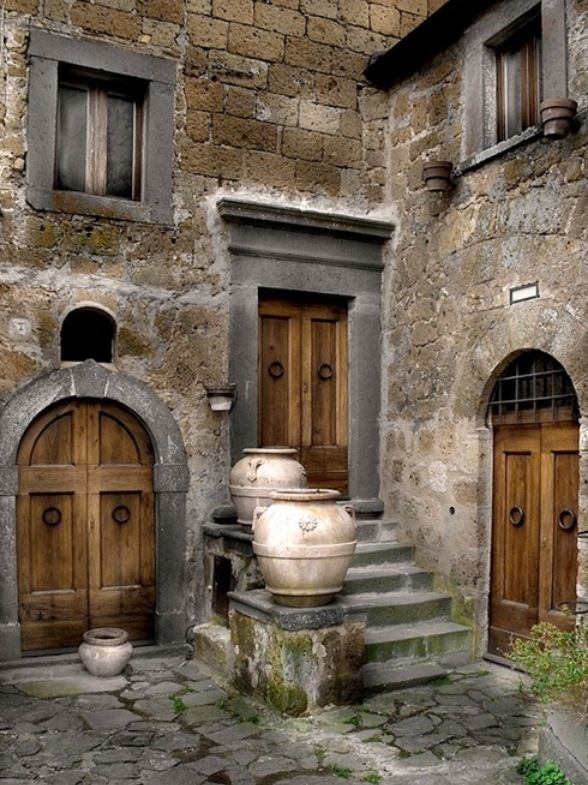 These three doors draw me in...Door 1, 2 or three? Which do I choose? Love this rustic feel it gives...