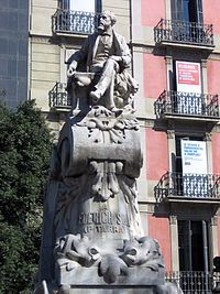 This statue is located in Theatre Square and is  a monument to the writer Seraph Pitarra who is considered to be the founder of Catalan theatre.  This combines two different forms of art and culture into another form of a lasting image, the statue.