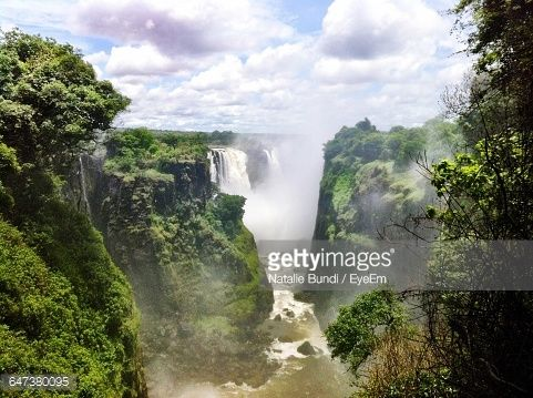 Stock Photo : Scenic View Of Victoria Falls Against Cloudy Sky