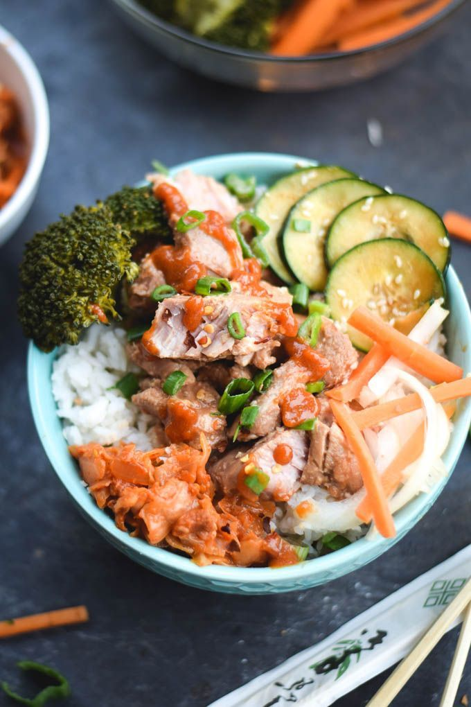 Spicy Korean Bulgogi Pork Bowls // bulgogi marinated pork shoulder, spicy bulgogi sauce, korean cucumber salad, rice, green onions, kimchi, steamed veggies