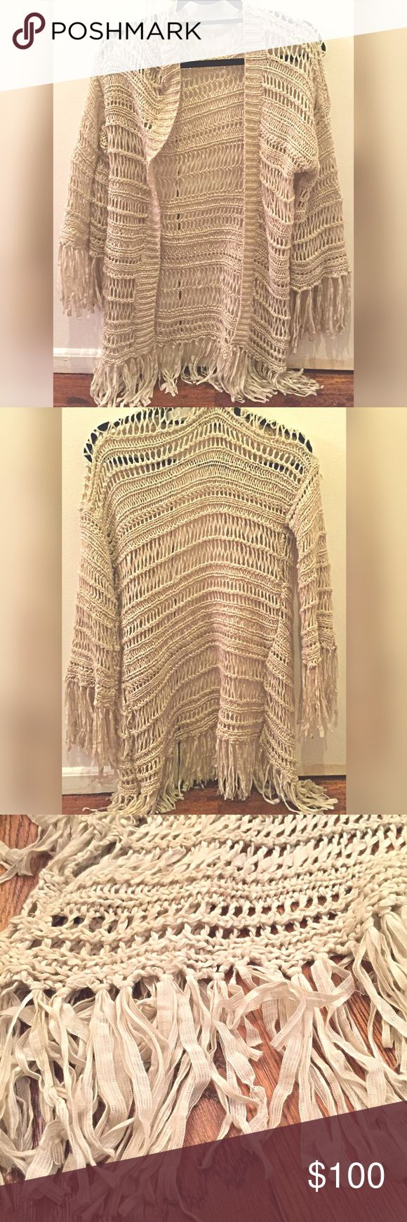 Over-Sized Fringe Cardigan Good condition. Fringed sleeves & bottom.  Easy to throw on over anything for a hippy chic look!  All reasonable offers accepted. LF Sweaters Cardigans