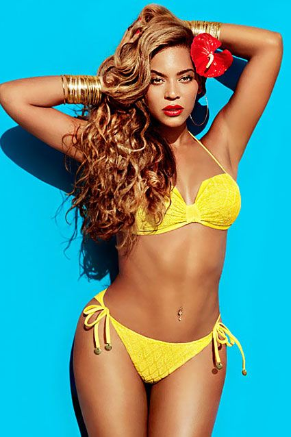 Beyonce sizzles in a bright yellow bikini and shows off her belly button ring in the newest H swimsuit campaign pics.